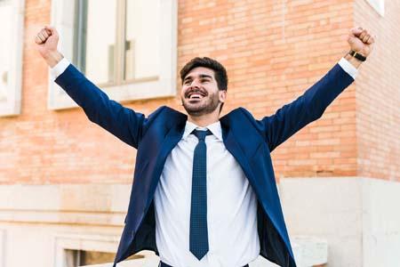 cheerful-man-successful-development-strategy